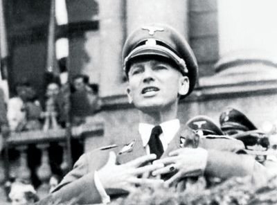 Governor of Galicia, Otto Wächter, showing off at a rally in front of the newly recruited SS Galicia Division.